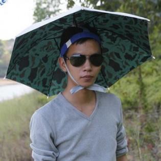 Sateenvarjo päähän