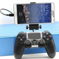 Kiinnitä ohjaimesi puhelimeen tällä kiinnikkeellä ja voit pelata kännykkäpelejä pleikkarin ohjaimella! Tämä auttaa myös vlogien harrastajia nauhoittamaan pelejään!