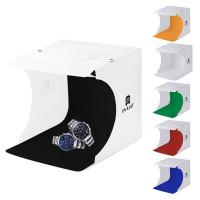 Mycket prisvärd 20 cm ljusbox / mini-fotostudio med inbyggda lysdioder och 6 olika bakgrundstyg.